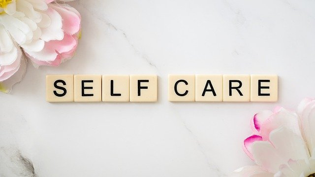 self care written with scrabble pieces